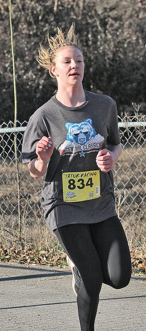 Peyton Pregler, shown during a road race last year in Bartlesville, is off to a fast start as a freshman runner with the Bartlesville High track team.