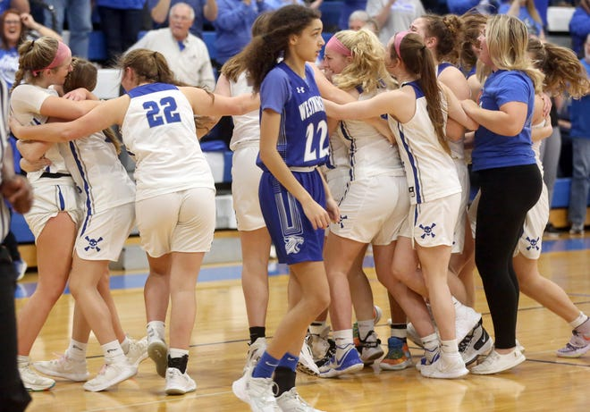 The Boonville Lady Pirates basketball team celebrates after beating Westminster Christian Academy 65-50 to move on to the Final Four this coming Friday in Springfield.