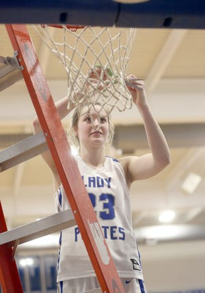 Boonville senior Brooke Eichelberger helps cut down the nets after beating Westminster Christian Academy 65-50 in a Class 4 quarterfinal game Saturday in Boonville.