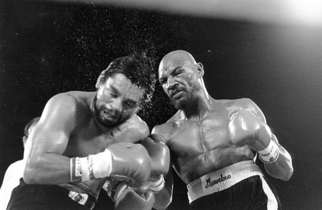 Marvin Hagler pounds challenger Roberto Duran in Las Vegas in November 1983. Hagler scored a unanimous decision over Duran.