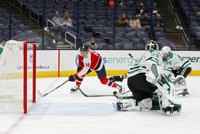 Blue Jackets center Max Domi scores on Dallas goaltender Jake Oettinger on Saturday. Domi has a goal and assist in consecutive games.