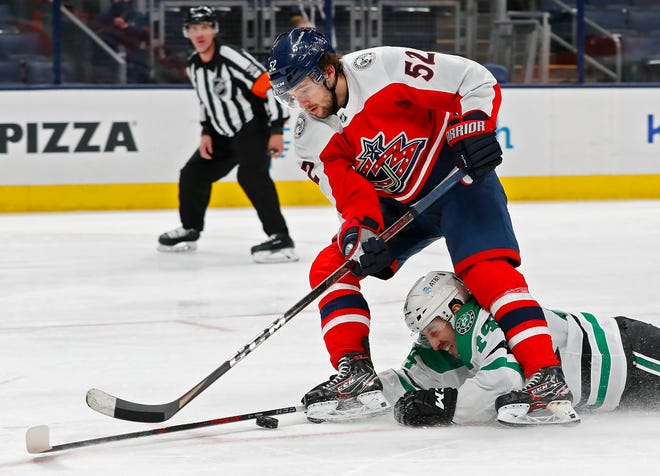 Dallas Stars defenseman Joel Hanley, bottom, takes out forward Emil Bemstrom on a breakaway during the third period of the Blue Jackets' 4-3 overtime win Saturday at Nationwide Arena. Bemstrom was awarded a penalty shot and didn't convert.