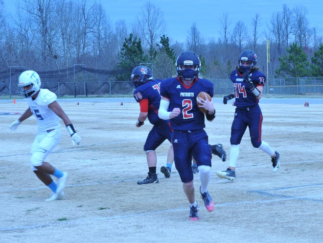 Providence Grove quarterback Luke Thomas scores on an 8-yard run. [Mike Duprez/Courier-Tribune]