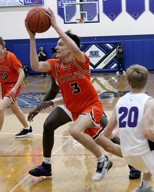 Meadowbrook junior Jake Singleton takes the ball to the basket during Saturday's Division II regional championship game with Columbus Desales at Southeastern High School in Chillicothe.