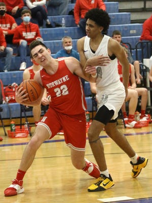 Norwayne's Joey Raudebaugh, left, with the ball defended by Lutheran East's Jared Lary during the OHSAA Division III Region 9 regional final played at Twinsburg High School Saturday, March 13, 2021.
