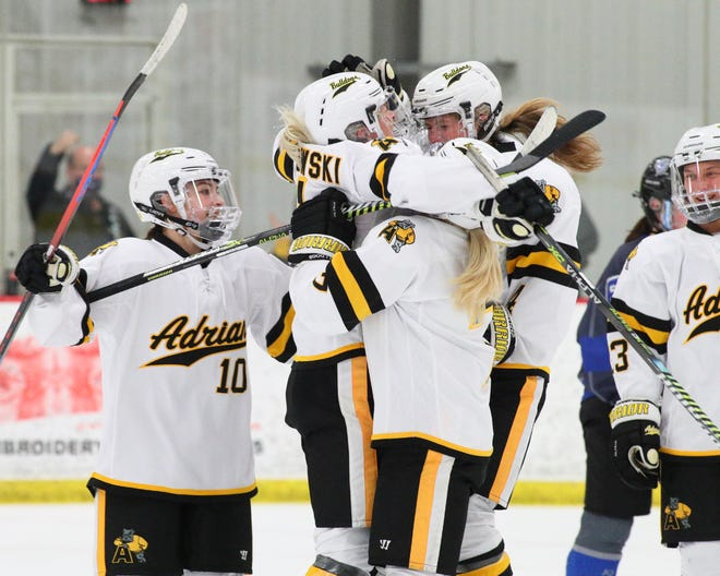 Adrian College's Kathryn Truban (left), Reaghan Pietrowski (left-center), Jaden Rilei (center) and Karmen Anderson (right-center) celebrate a goal during Sunday's Slaats Cup semifinal game against Aurora.