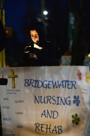 Jack Luongo during a candlelight vigil commemorating the one-year anniversary of the COVID-19 pandemic lockdown on Saturday, March 13, 2021, at Central Square in Bridgewater. The evening honored the lives of long-term care residents who lost their battle to COVID-19 and celebrated the resilience of survivors.