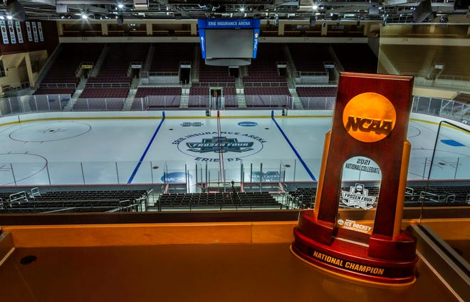 Erie Insurance Arena is ready for the NCAA Division I women's hockey quarterfinals and Frozen Four from March 15-21 2021. Pictured in a suite at the arena is a replica of the national championship trophy that eight college teams will be playing to win this week.