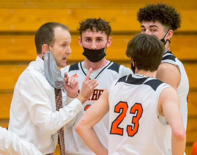 Washington head coach Eric Schermerhorn, left, talks with Ethan Kienitz (23), Devon Vanderheydt, right, and Andrew Coker during a break in the action in the second half of the Mid-Illini Conference title game Saturday, March 13, 2021 in Washington. The Panthers defeated the Metamora Redbirds 69-52 for the title.