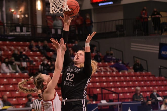 Truman's Ellie Weltha puts up a shot during the first half of Saturday's NCAA Tournament game against Drury.