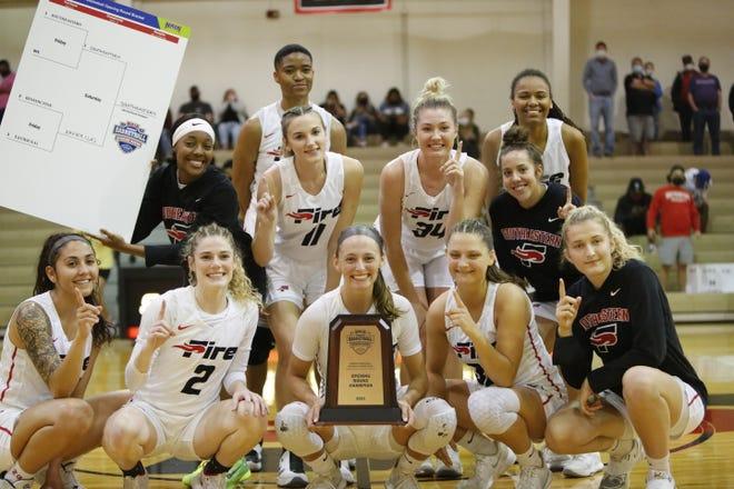 Southeastern's women's basketball team celebrates their win over Xavier to advance to the NAIA Women's Tournament Round of 16 next week.