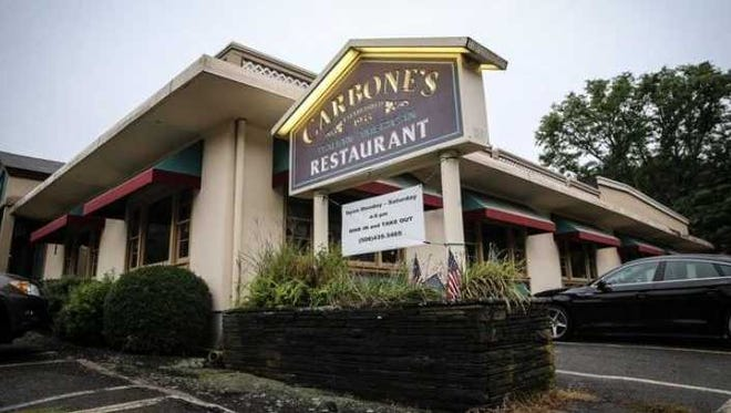 Even though its owners had announced last fall they were closing, Carbone's Restaurant in Hopkinton remains open for business. Owners say they will listen to offers.