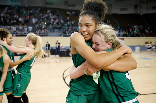 Jones' Tirzah Moore, left, and Jaelen Maples celebrate after beating Roland for the Class 3A state title Saturday night at State Fair Arena.