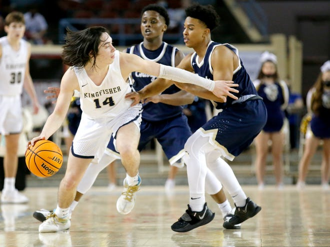 Kingfisher's Bijan Cortes (14) looks to get around Heritage Hall's Ethan Franks (0) during the Class 4A state championship game on March 13.