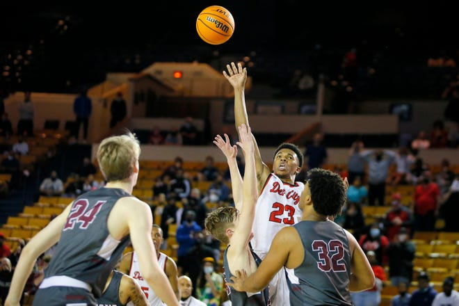Del City's Javeon McCalister makes a basket in the final seconds of a 47-44 win over Edmond Memorial in the Class 6A state championship game at the Mabee Center in Tulsa.