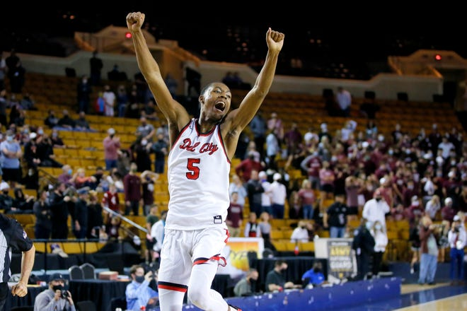 Del City's Keyondre Young celebrates after beating Edmond Memorial in the Class 6A state championship game on March 13 at the Mabee Center in Tulsa.