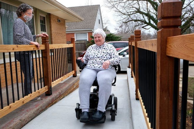 Kendra Orcutt built a wheelchair-friendly ramp on the front of her house so big and nice it looks like a porch, making the house accessible to her mother, Nancy Orcutt, but still attractive.
