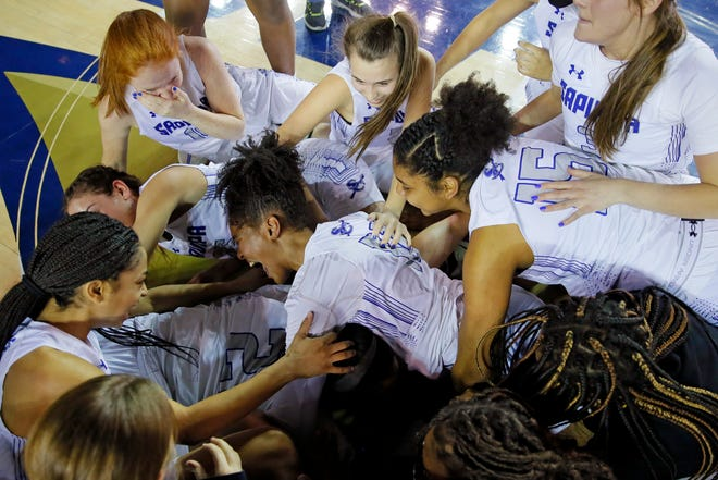 Sapulpa's players, including Alexis Lewis, celebrate after winning the Class 5A girls state tournament championship game against Tahlequah at the Mabee Center in Tulsa on Saturday.