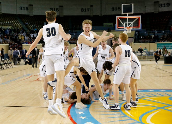 Kingfisher's Maverick Ridenour (30) and Kingfisher's Drake Friesen (5) celebrate the Class 4A boys high school basketball state championship after defeating Heritage Hall at State Fair Arena in Oklahoma City on Saturday.
