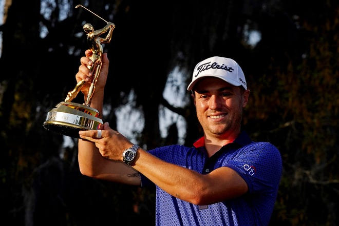Justin Thomas celebrates with the trophy after winning The Players Championship at TPC Sawgrass Sunday. [Jasen Vinlove-USA TODAY Sports]