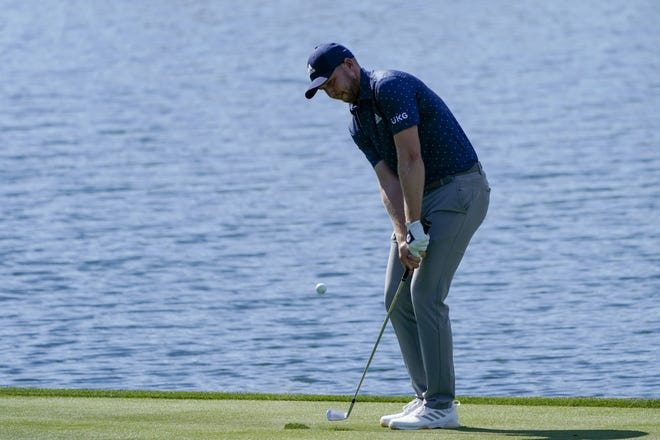 Jupiter's Daniel Berger chips to the green on the 18th hole Friday at the The Players Championship. Berger is dealing with a rib injury and hopes it does not force him to miss this week's Honda Classic. (AP Photo/Gerald Herbert)