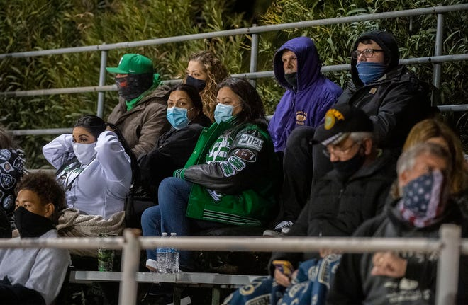 St. Mary's fans watch the varsity team play at De La Salle in Concord.