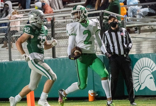 St. Mary's Jadyn Marshall cruises in for a touchdown during a varsity football game March 13 at De La Salle High School in Concord.