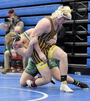 Kenny Marra of West Branch takes down Gary Powell of Mt. Orab Western Brown in their 220-pound match in the Div. II state wrestling tournament at Marengo Hiland Saturday.