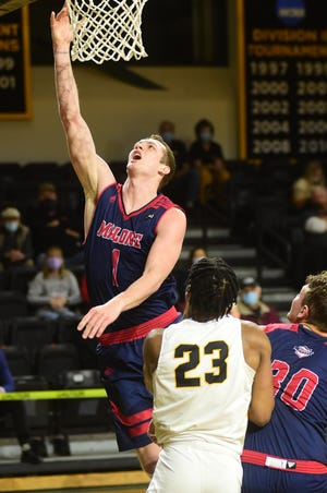 Malone's Marcus Ernst (1) goes up for a shot during Saturday's NCAA Division II Atlantic Regional game against West Liberty