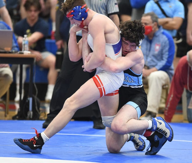 Brenden Severs of Louisville works to take down Zayne Lehman of Revere in their 182-pound semifinal match in the Division II state wrestling tournament Sunday at Marengo Highland High School.