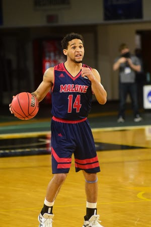 Malone's Bryce Butler calls out a play during Saturday's NCAA Division II Atlantic Regional game against West Liberty.