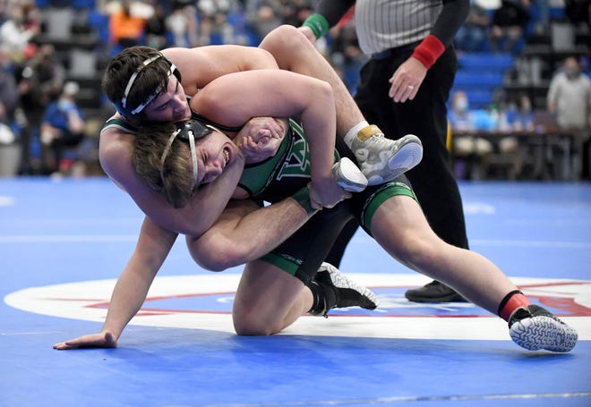 Bryson Getz of Akron St. Vincent St. Mary has control of Kenny Marra of West Branch in their 220-pound semifinal match Sunday at Marengo Highland High.