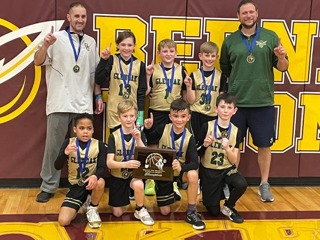 """The GlenOak third grade boys basketball team went 34-2 this winter, winning five tournaments, including a state tournament in Columbus in late February. Team members are (front row, left to right) Derrick """"DJ"""" Jones, Andrew Minnie, Anthony Broom, Zach Miller, (back row) coach Beau Broom, Kash Gillespie, Spencer Brunoni, Maksim Courtney and coach Chris Miller. Not pictured is Will Foltz."""