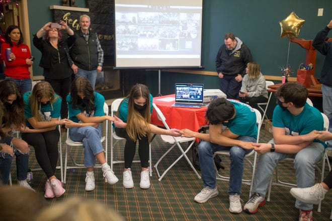 The Belvidere North cheerleading team waits to hear the announcement of their second-place finish in the virtual state competition during a watch party at Timber Pointe Golf Club on Saturday, March 13, 2021, in Poplar Grove.
