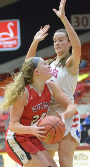 McPherson forward Grace Pyle (24) looks to put up a shot against Bishop Miege's Payton Verhulst (22) during the second half of the Class 4A state championship game Saturday night at the Tony's Pizza Events Center.