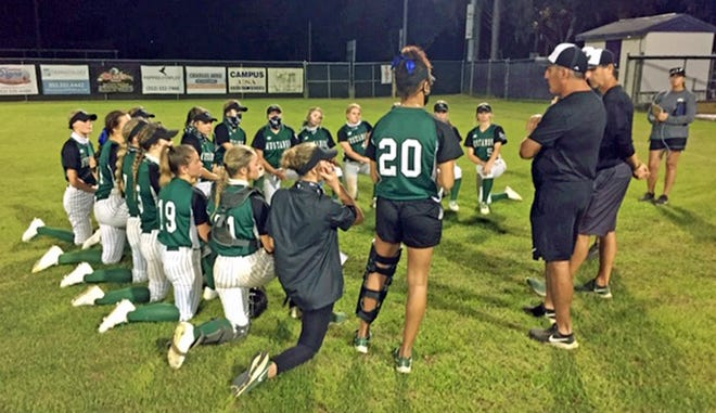 Lakewood Ranch HIgh softball coaches speak with the team after the Mustangs swept a doubleheader Saturday in Gainesville.