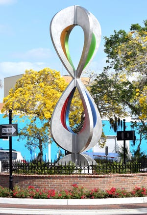 """Blessing Hancock's """"Embracing Our Differences"""" sculpture was placed in a roundabout at Orange Avenue and Main Street in downtown Sarasota in 2016."""