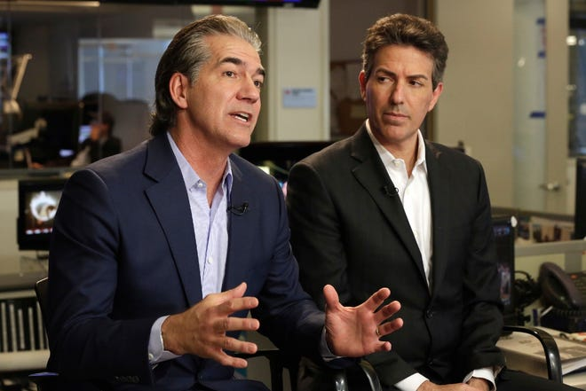 SeaWorld President and CEO Joel Manby, left, and Wayne Pacelle, President and CEO of The Humane Society of the United States, are interviewed in New York, Thursday, March 17, 2016. Finally bowing to years of public pressure, SeaWorld announced Thursday that it will immediately stop breeding killer whales, and soon stop making them perform theatrical tricks.