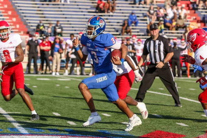 Savannah State quarterback D'Vonn Gibbons (3) keeps the ball and runs 37 yards for a touchdown against West Alabama on Saturday, March 13, 2021, during the third annual Gulf Coast Challenge game at Ladd-Peebles Stadium in Mobile, Ala. West Alabama won 36-28.