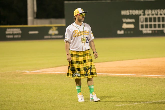 Savannah Bananas Premier Team manager Nate Fish coaches at third base during  the squad's debut against the Party Animals on Saturday at Grayson Stadium.