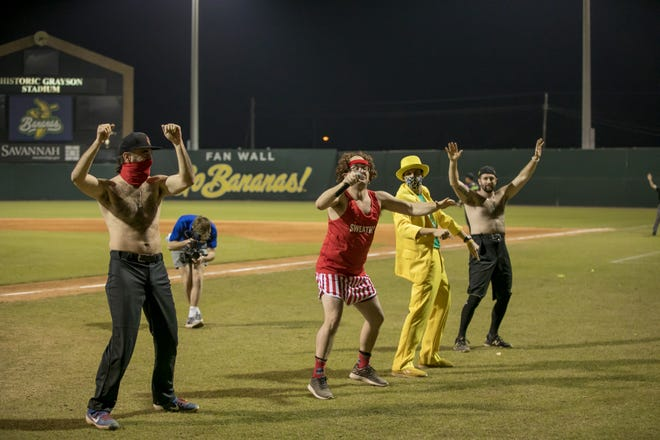 Savannah Bananas team co-owner Jesse Cole, in a yellow tuxedo, entertains the crowd with some friends between innings at Saturday's game between the Premier Team and the Party Animals at Grayson Stadium.