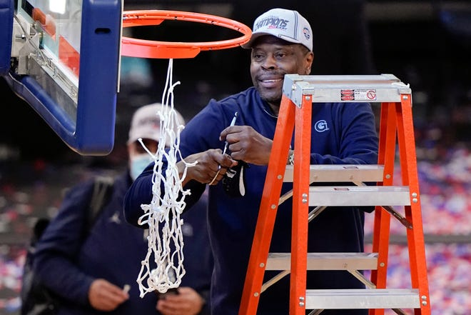 Georgetown head coach Patrick Ewing cuts down the net after his team routed Creighton to win the Big East Conference tournament Saturday, March 13, 2021, in New York.