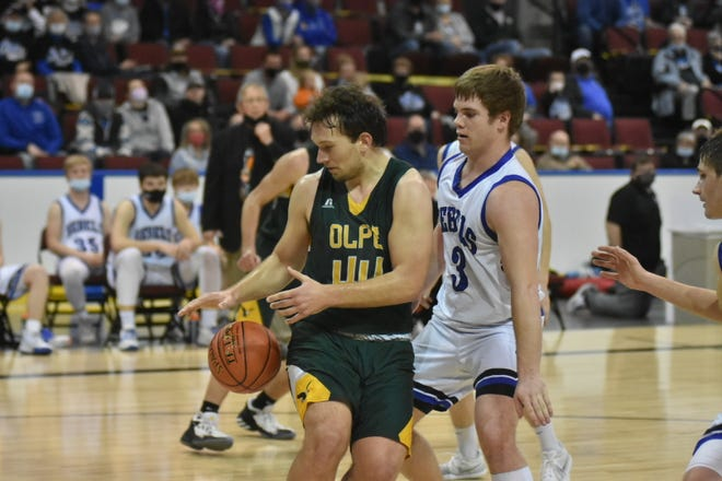 Olpe's Chris Olsson tries to get control of the ball while being pressured by South Gray's Aaron Skidmore during Saturday's Class 1A Division I boys state championship game in Dodge City. Olpe won 54-47 to capture its first state championship.