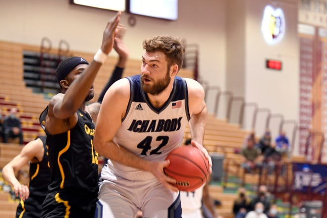 Washburn's Jonny Clausing looks for an opening during Saturday night's NCAA Division II Tournament opener against Missouri Western in Aberdeen, S.D. Clausing recorded team-highs of 14 points and 12 rebounds in the Ichabods' 72-46 victory.