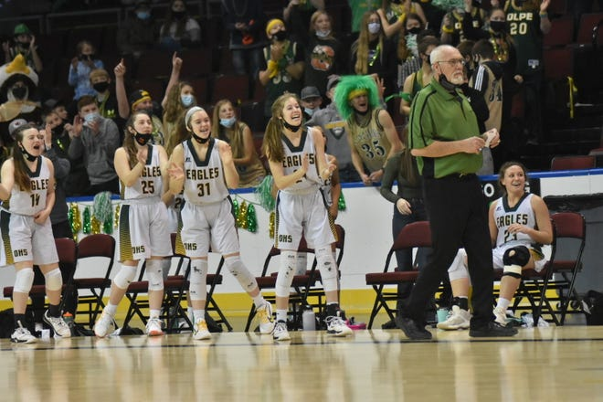 Olpe's bench celebrates as the seconds tick down on their 42-25 win over Norwich in Saturday's Class 1A Division I state championship game. The Eagles finished undefeated for the fifth time in school history.
