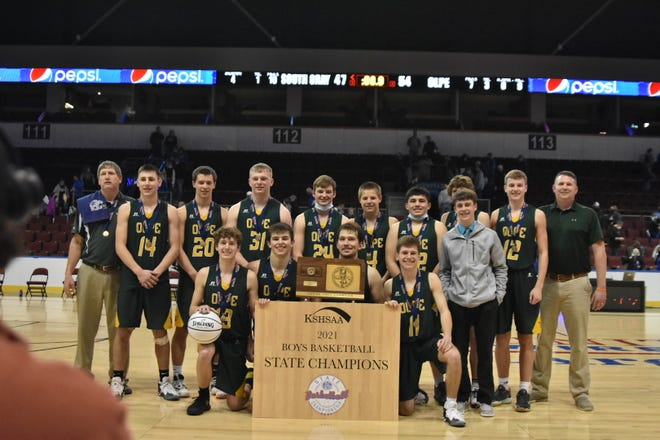 Olpe's boys pose with the Class 1A Division I state championship trophy after knocking off undefeated South Gray 54-47 for the program's first state title.