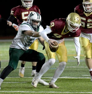While on defense, Wachusett's Owen Champagne catches Doherty's Colin Schoen from behind during a 2019 game.