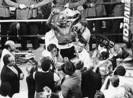 The Petronelli brothers hoist Marvelous Marvin Hagler after the boxer retained his world middleweight title by defeating Tony Sibson on Feb. 11, 1983, at the Centrum in Worcester.