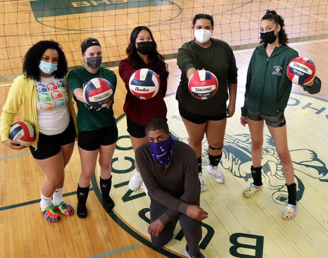 Burncoat seniors, from top left, Joycette Cotto, Sabrina Paladino, Kim Nguyen, Shianne Harewood, Kayla Morales and coach Phil Malette, front, before a recent practice.