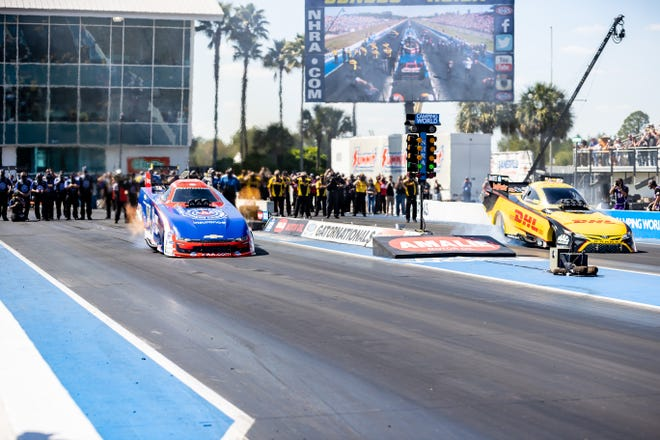 Funny Car dragsters take off in the final race Sunday during the AMALIE Motor Oil NHRA Gatornationals at Gainesville Raceway.